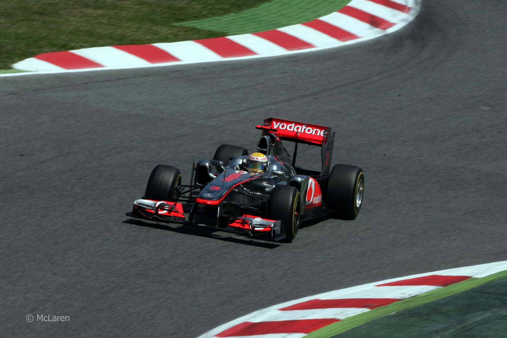 Vettel wins titanic battle in